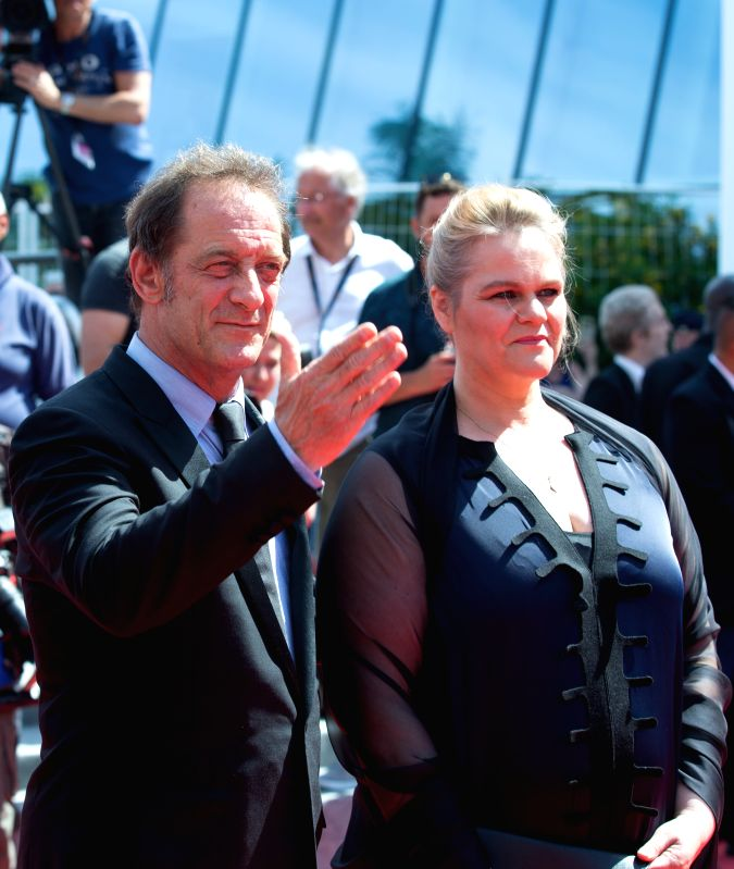 "CANNES, May 24, 2017 - French actor Vincent Lindon (L) and Belgian actress Severine Caneele pose on the red carpet for the screening of the film ""Rodin"" during the 70th Cannes Film Festival ... - Vincent Lindon"