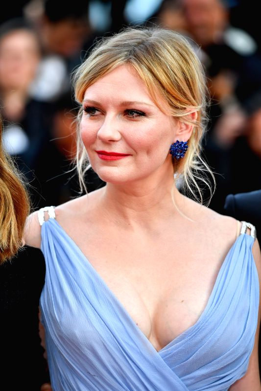 "CANNES, May 24, 2017 - U.S. actress Kirsten Dunst poses for photos on the red carpet for the screening of the film ""The Beguiled"" in competition at the 70th Cannes Film Festival in Cannes, ... - Kirsten Dunst"
