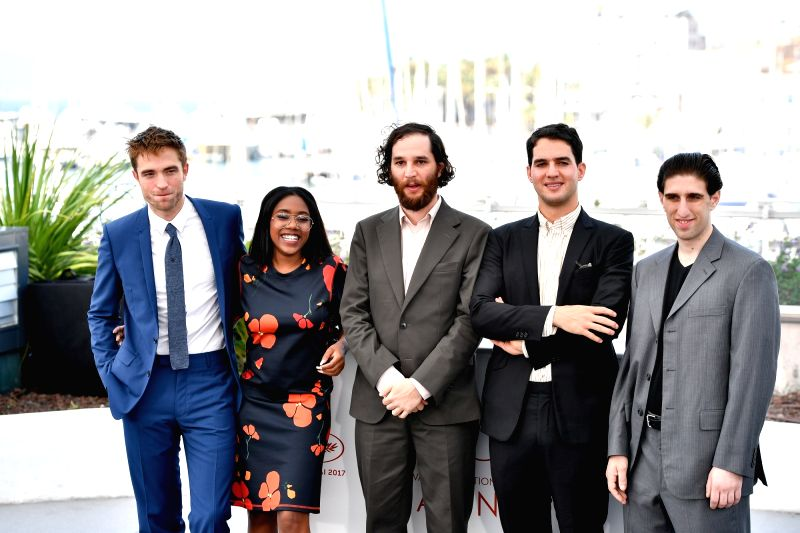 "CANNES, May 25, 2017 - Actor Robert Pattinson, actress Taliah Webster, director Josh Safdie, director Benny Safdie and actor Buddy Duress (from L to R) of the film ""Good Time"" pose for a ... - Robert Pattinson"