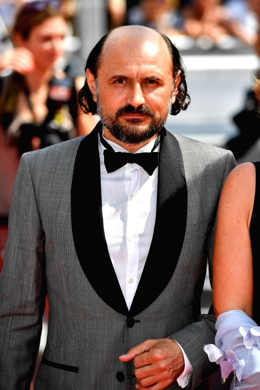 """CANNES, May 25, 2017 - Actor Valeriu Andriuta poses for photos on the red carpet for the screening of the film """"A Gentle Creature"""" in competition at the 70th Cannes Film Festival in Cannes, ... - Valeriu Andriuta"""