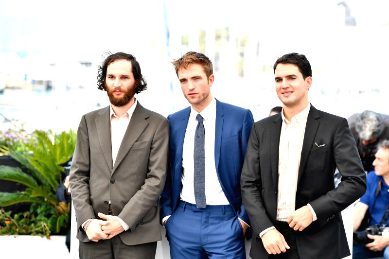 "CANNES, May 25, 2017 - Director Josh Safdie, actor Robert Pattinson and director Benny Safdie (from L to R) of the film ""Good Time"" pose for a photocall in Cannes, France on May 25, 2017. ... - Robert Pattinson"