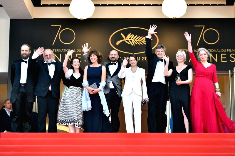 """CANNES, May 25, 2017 - Director Sergei Loznita (3rd R) and cast members of the film """"A Gentle Creature"""" pose for photos on the red carpet for the screening of the film """"A Gentle ..."""