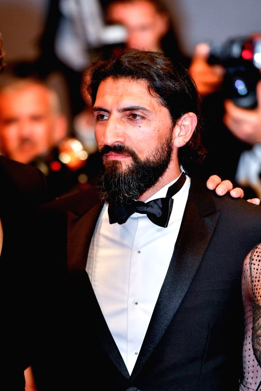 "CANNES, May 26, 2017 - German actor Numan Acar poses for photos on the red carpet for the screening of the film ""In the Fade"" in competition at the 70th Cannes Film Festival in Cannes, ... - Numan Acar"