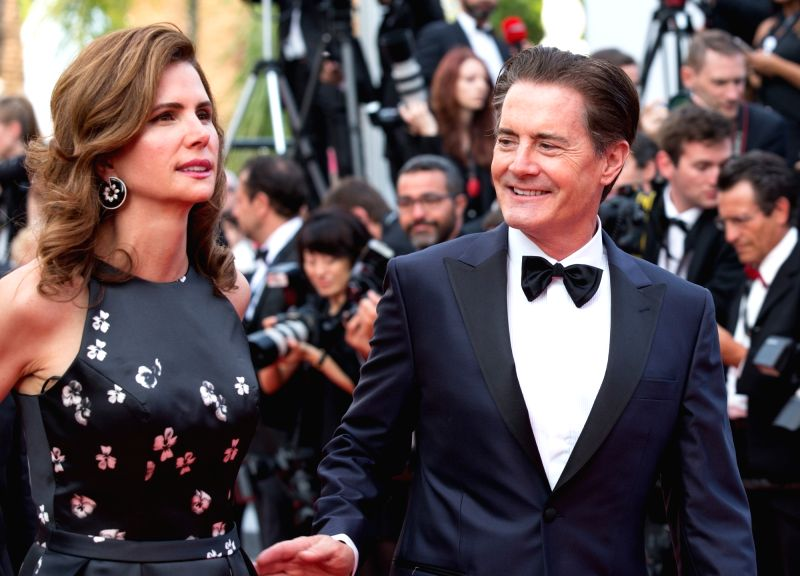 "CANNES, May 26, 2017 - US actor Kyle MacLachlan and his wife Desiree Gruber pose on the red carpet for the screening of the new episodes of ""Twin Peak"" during the 70th annual Cannes Film ... - Kyle Mac"