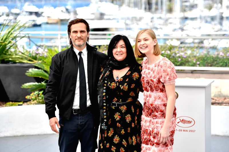 """CANNES, May 27, 2017 - Actor Joaquin Phoenix, director Lynne Ramsay and actress Ekaterina Samsonov (from L to R) of the film """"You Were Never Really Here"""" pose for a photocall in Cannes, ... - Joaquin Phoenix"""