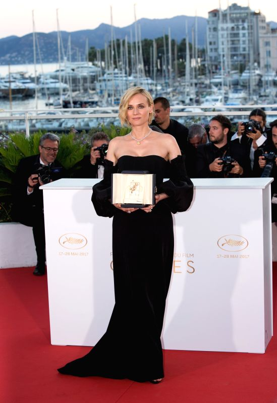 "CANNES, May 29, 2017 - Actress Diane Kruger, winner of the Best Actress Award for the film ""In The Fade"", poses during a photocall at the 70th Cannes Film Festival in Cannes, France, May ... - Diane Kruger"