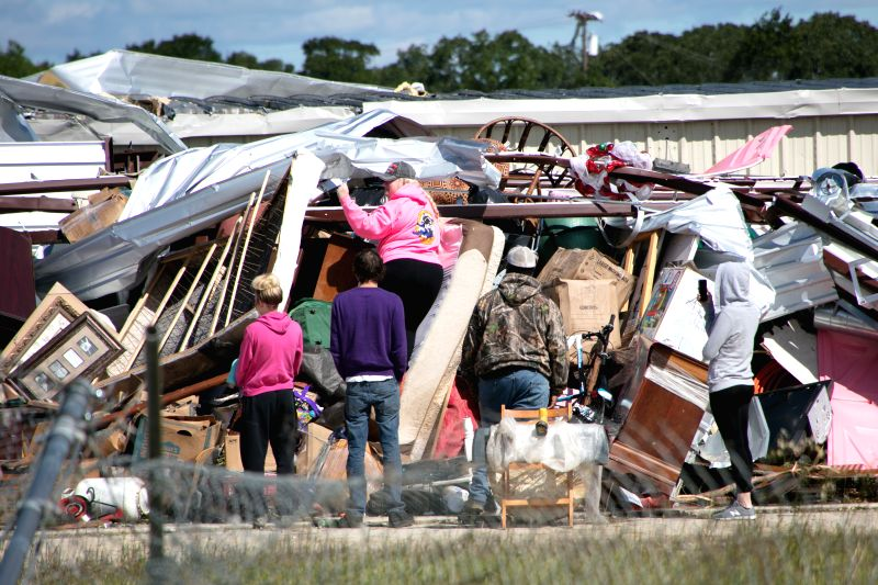 CANTON (U.S.), April 30, 2017 People remove the debris as they salvage belongings after tornadoes in Canton, the United States, on April 30, 2017. At least five people were killed and 49 ...