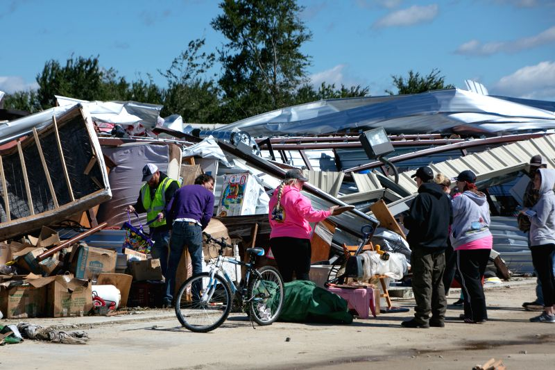 CANTON (U.S.), April 30, 2017 People salvage belongings after tornadoes in Canton, the United States, on April 30, 2017. At least five people were killed and 49 others injured Saturday ...