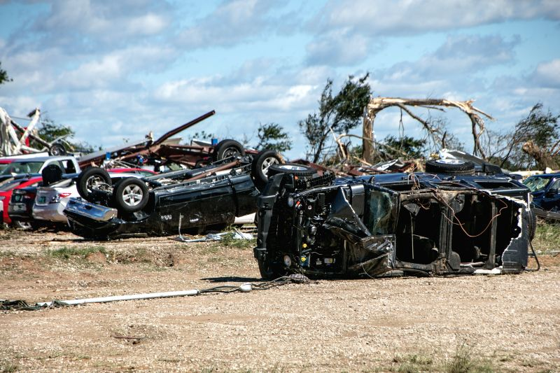 CANTON (U.S.), April 30, 2017 Photo taken on April 30, 2017 shows destroyed vehicles after tornadoes in Canton, the United States. At least five people were killed and 49 others injured ...