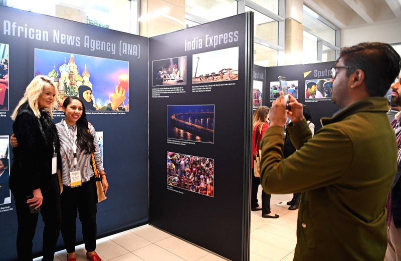 CAPE TOWN, July 18, 2018 - Media delegates pose for photos at the second edition of BRICS Media Joint Photo Exhibition in Cape Town, South Africa, July 18, 2018. The second edition of BRICS Media ...