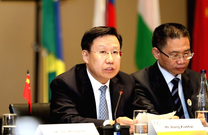 CAPE TOWN, July 18, 2018 - Wang Xiaohui (L), executive deputy head of the Publicity Department of the Central Committee of the Communist Party of China and executive vice director of the Policy ...