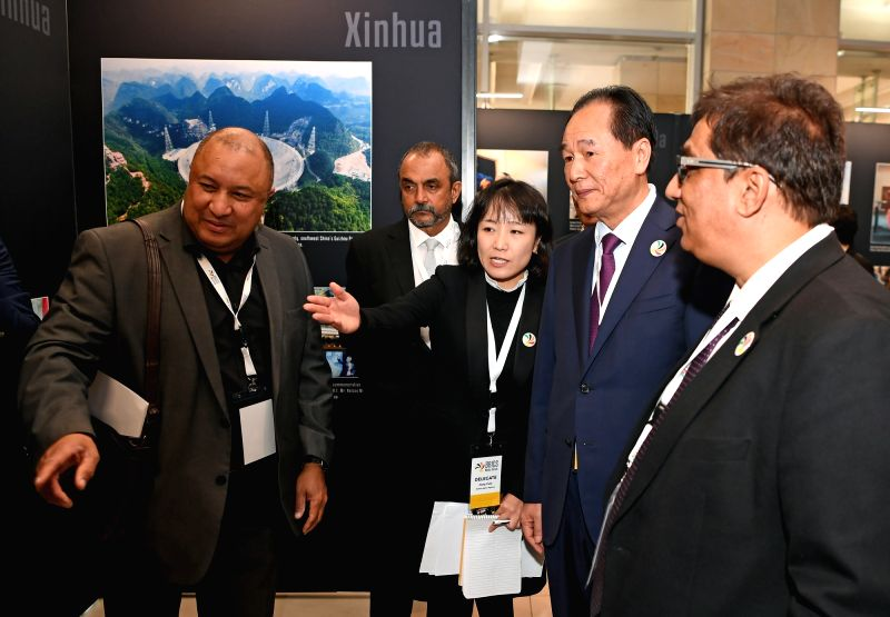 CAPE TOWN, July 19, 2018 - Co-chairmen of the BRICS Media Forum and media delegates view photos at the second edition of BRICS Media Joint Photo Exhibition in Cape Town, South Africa, July 18, 2018. ...