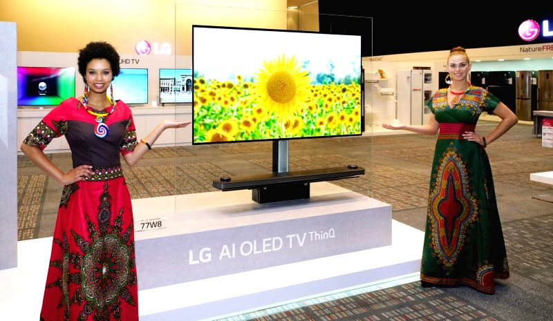 Cape Town: Models display an LG Signature OLED TV at an event in Cape Town, South Africa, on Jan. 31, 2018.