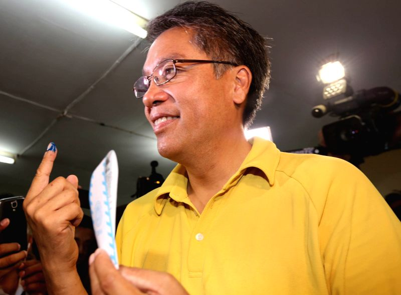 CAPIZ PROVINCE, May 9, 2016 - Presidential candidate Mar Roxas shows his index finger marked with indelible ink after casting his vote in Capiz Province, the Philippines, May 9, 2016. Millions of ...