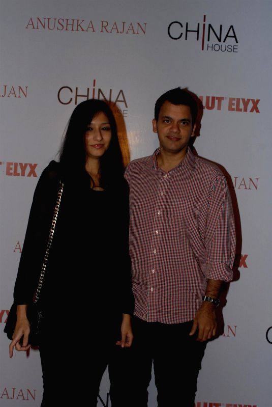 Caption : Fashion designer Nachiket Barve along with his wife Surabhi during the Absolut Elix and Anushka Ranjan fashion preview in Mumbai, on July 31, 2014.