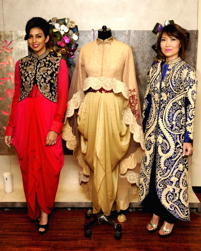 Caption : Kolkata: Models Nina Saxer and Sonika Chauhan during a programme organised to celebrates 1st Anniversary of their flagship store in Kolkata, on April 4, 2015.
