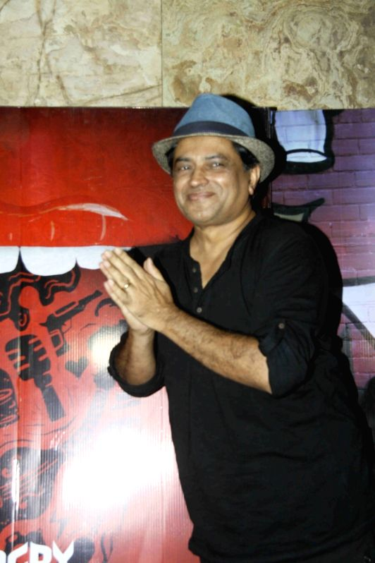 Caption : Mumbai: Actors cum Filmmaker Pan Nalin during the screening of film Angry Indian Goddesses in Mumbai  Nov  30, 2015 - Pan Nalin