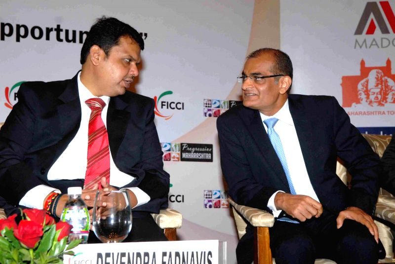 Mumbai: Maharashtra Chief Minister Devendra Fadnavis with Chairman and CEO of the Edelweiss Group Rashesh Shah at the `4th Annual Conference  Progressive Maharashtra 2015` organised by FICCI - Devendra Fadnavis and Group Rashesh Shah