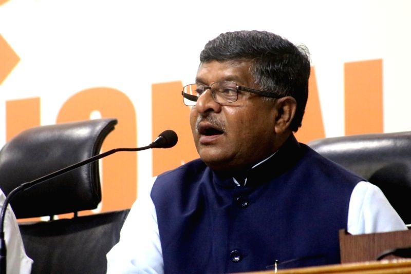 Caption : New Delhi: Union Minister for Communications and Information Technology Ravi Shankar Prasad addresses a press conference regarding violence in Kerala; in New Delhi, on May 21, 2016.