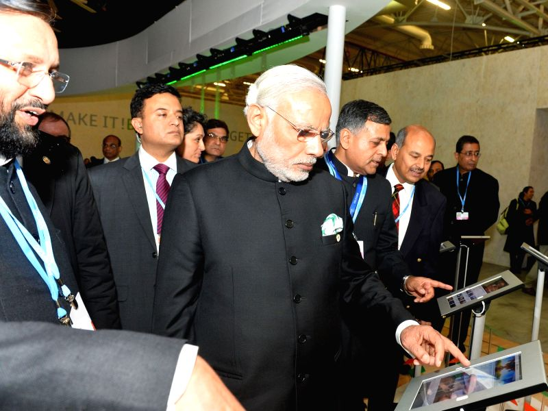 Caption : Paris: Prime Minister Narendra Modi visits the India Pavilion, at COP21 Summit, in Paris, France on Nov 30, 2015. Also seen the Minister of State for Environment, Forest and Climate Change ... - Narendra Modi