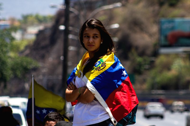 A girl takes part in a student protest against the government of President Nicolas Maduro at the Prados del Este highway in Caracas, Venezuela, on April 10, 2014. .