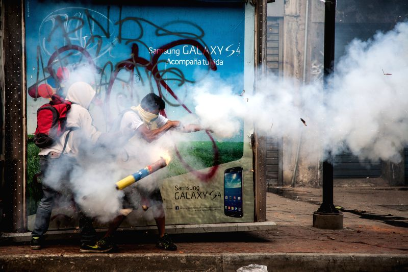Demonstrators clash with members of the Bolivarian National Guard during an anti-government protest in the municipality of Chacao, east of Caracas, Venezuela, on ..