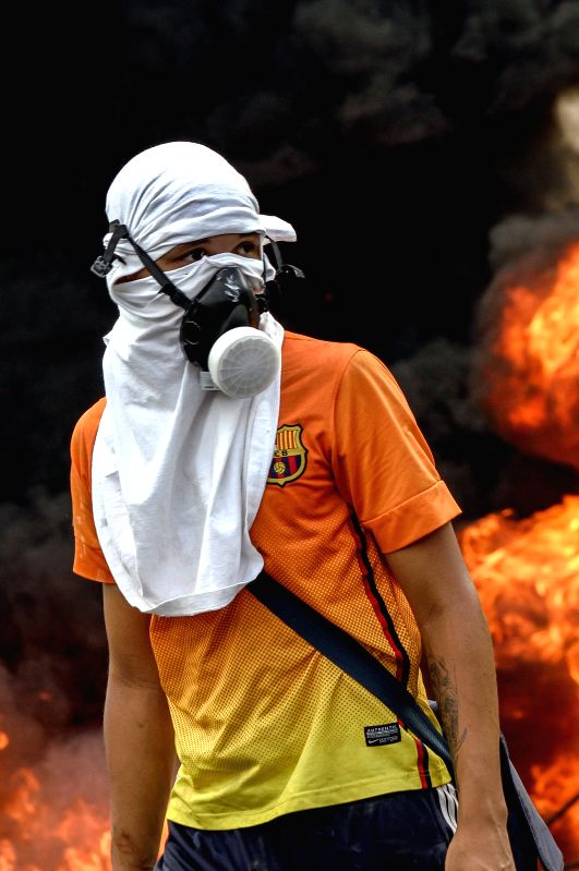 "CARACAS, April 25, 2017 - A demonstrator takes part in a protest in Caracas, Venezuela, on April 24, 2017. Venezuelan Foreign Minister Delcy Rodriguez on Saturday called for ""true and ... - Delcy Rodriguez"