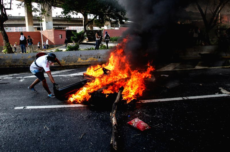 "CARACAS, April 25, 2017 - Demonstrators put a barricade during a protest in Caracas, Venezuela, on April 24, 2017. Venezuelan Foreign Minister Delcy Rodriguez on Saturday called for ""true and ... - Delcy Rodriguez"