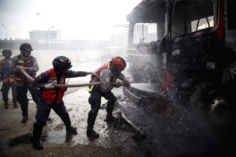"CARACAS, April 25, 2017 - Firemen extinguish flames during a protest in Caracas, Venezuela, on April 24, 2017. Venezuelan Foreign Minister Delcy Rodriguez on Saturday called for ""true and ... - Delcy Rodriguez"