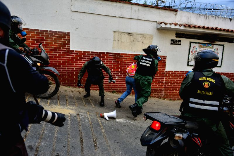 A person is detained by Bolivarian National Guards during a protest at El Guaire neighborhood in Caracas, Venezuela, April 26, 2014.