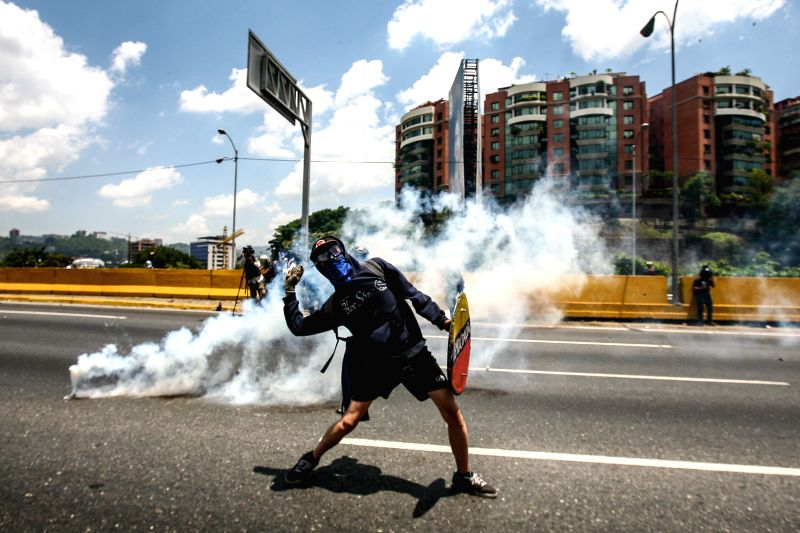 CARACAS, April 27, 2017 - An opposition supporter takes part in a protest in Caracas, Venezuela, on April 26, 2017. Venezuela's Foreign Minister Delcy Rodriguez said Wednesday that the country would ... - Delcy Rodriguez