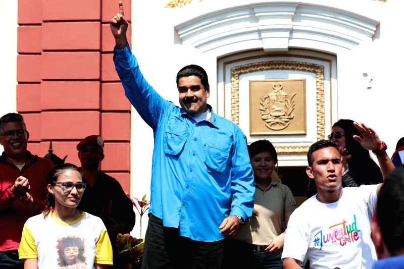 CARACAS, April 27, 2017 - Image provided by Venezuela's Presidency shows Venezuelan President Nicolas Maduro (C) greeting the participants during a march of Venezuelan youth in defense of peace and ... - Delcy Rodriguez
