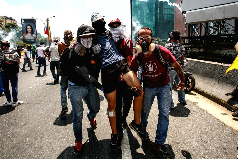 CARACAS, April 27, 2017 - Opposition supporters take part in a protest in Caracas, Venezuela, on April 26, 2017. Venezuela's Foreign Minister Delcy Rodriguez said Wednesday that the country would ... - Delcy Rodriguez