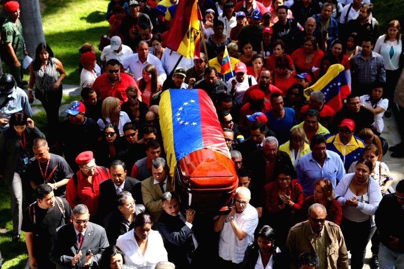 People carry the coffin of Eliecer Otaiza, councilor of the Caracas Libertador Municipality and former director of Venezuela's Intelligence Police in front of the .