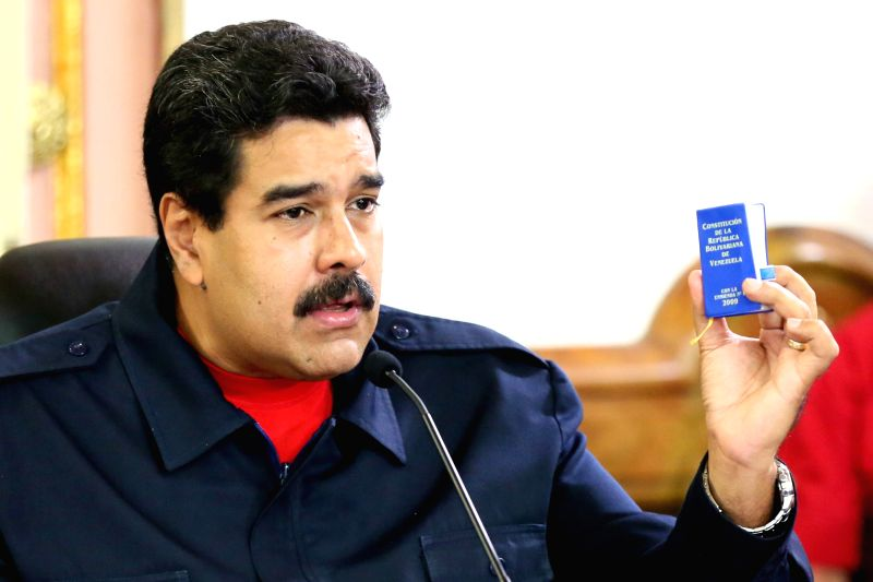 Venezuela's President Nicolas Maduro delivers a speech during a conference with members of the working class in Miraflores Palace in Caracas, Venezuela, on April ..