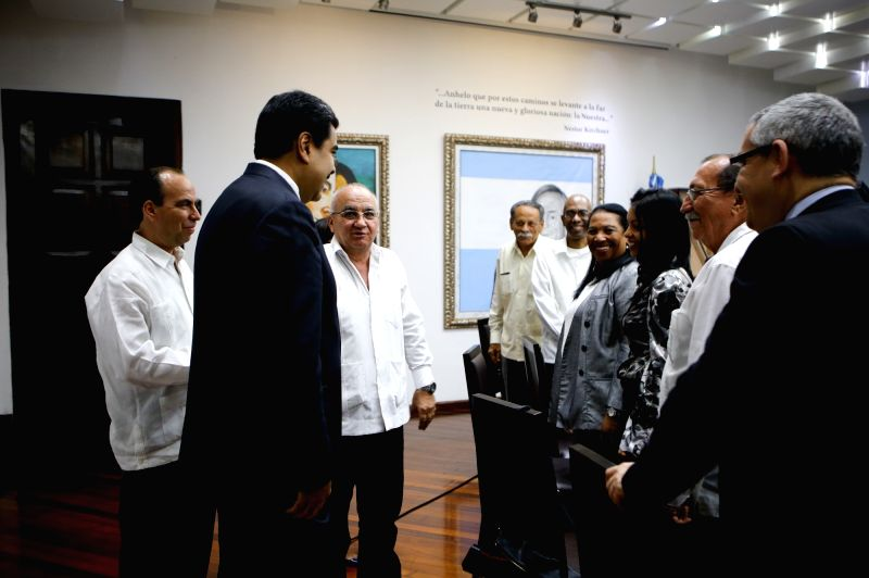 CARACAS, April 5, 2016 - Image provided by Venezuela's Presidency shows Venezuelan President Nicolas Maduro (2nd, L) heading a meeting with Cuba-Venezuela high-level commission at the Miraflores ...
