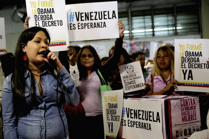 The Minister for the Woman and Gender Equality, Andreina Tarazon (L), gives a speech during a campaign to collect signatures, in Caracas, Venezuela, April 6, 2015. ...