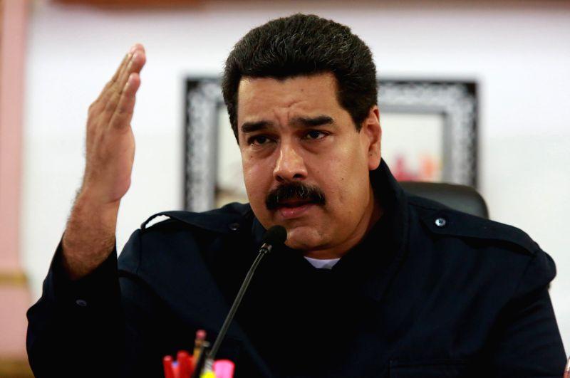 Venezuelan President Nicolas Maduro delivers a statement at Miraflores Palace, in Caracas, Venezuela, on Aug. 20, 2014. Nicolas Maduro announced on Wednesday the ...