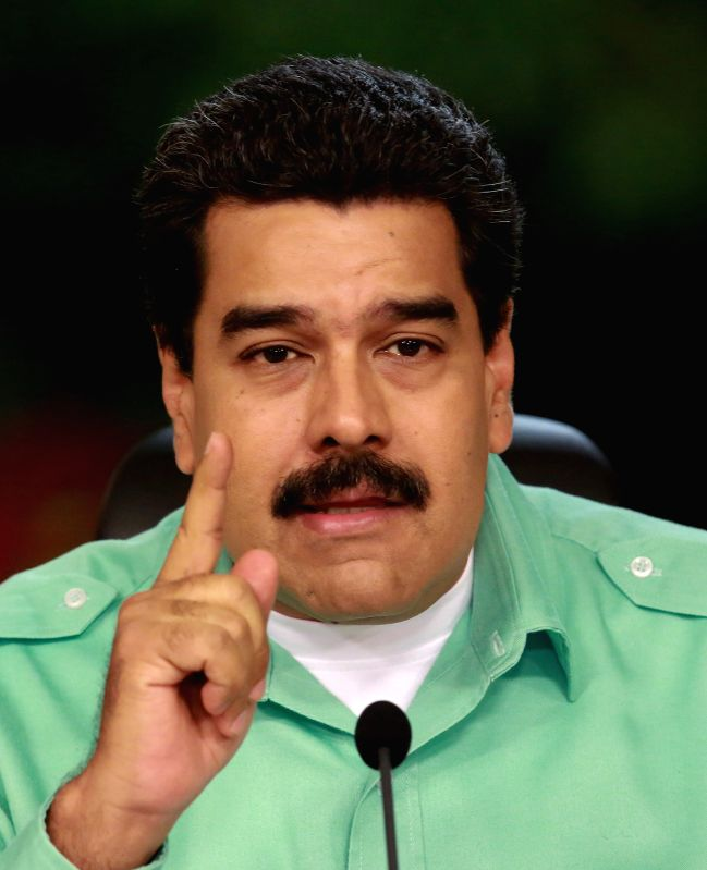 Venezuelan President Nicolas Maduro takes part in a TV broadcast to offer a balance of the actions that the government is taking against smuggling, at the ...