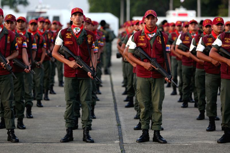 Members of the National Bolivarian Guard participate in the commemoration of its 77th anniversary in the Tiuna Fort in Caracas, Venezuela, on Aug. 4, 2014. ...