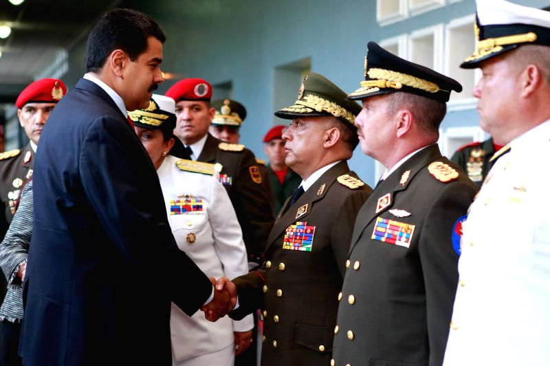 Venezuelan President Nicolas Maduro (L) participates in the commemoration of the 77th anniversary of the National Bolivarian Guard in the Tiuna Fort in Caracas, ...