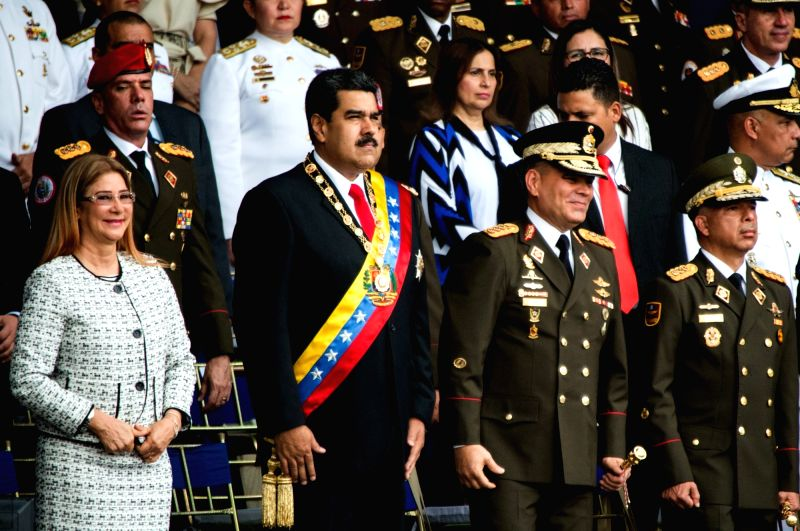 CARACAS, Aug. 5, 2018 - Venezuelan President Nicolas Maduro (2nd L) attends the commemoration of the 81st anniversary of the National Guard in Caracas Aug. 4, 2018. Venezuela's Minister of ...