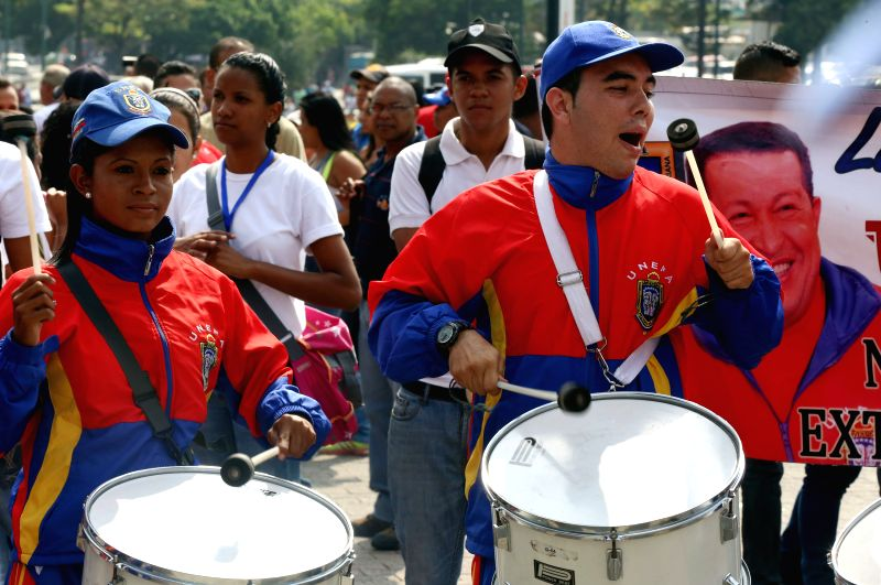 People take part in a march marking the 201st anniversary of the Battle of the Victory and the Youth Day in Caracas, Venezuela, on Feb. 12, 2015.  (Xinhua/Gregorio .