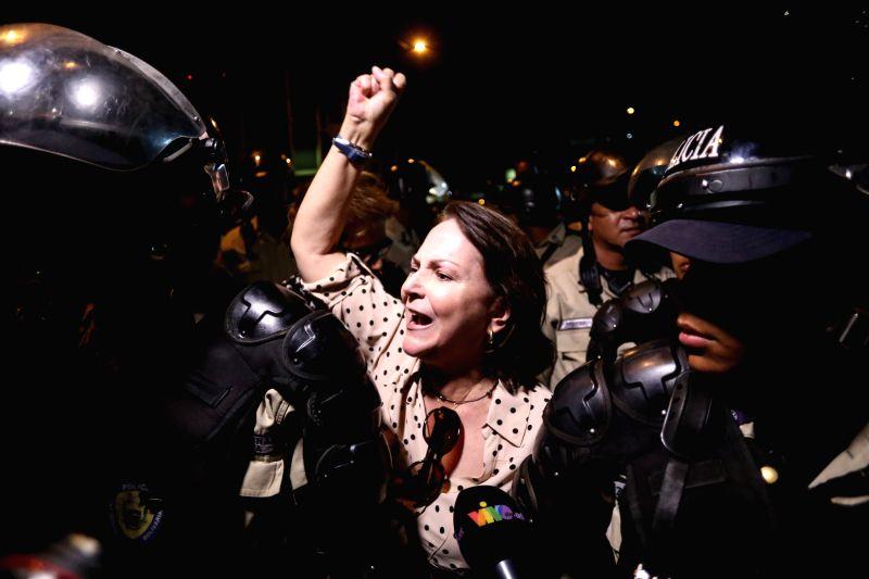 Mitzy Capriles de Ledezma (C), wife of Caracas Mayor Antonio Ledezma, reacts in front of the installations of the National Intelligence Service (SEBIN), in Caracas, ...