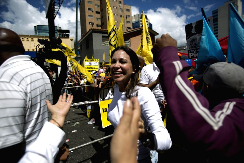 "Former Congresswoman and opposition leader Maria Corina Machado (C) takes part in the ""March of Empty Pots"" march in Caracas, capital of Venezuela, on ..."