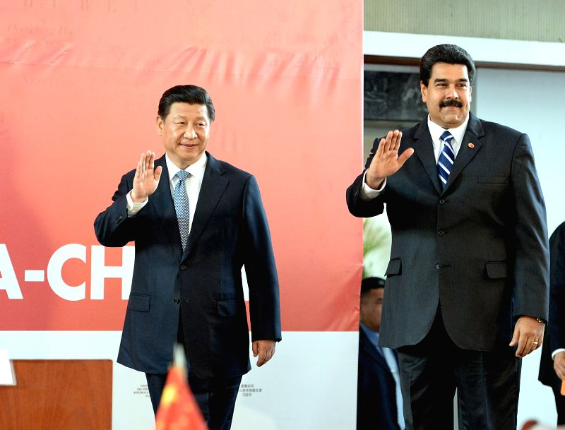 Chinese President Xi Jinping (L) and his Venezuelan counterpart Nicolas Maduro attend the closing ceremony of the 13th meeting of the China-Venezuela High-Level ...