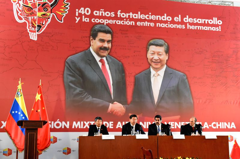 Chinese President Xi Jinping (2nd L) and his Venezuelan counterpart Nicolas Maduro (2nd R) attend the closing ceremony of the 13th meeting of the China-Venezuela ...