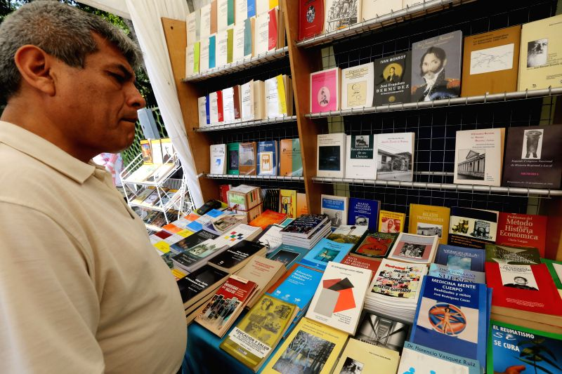 A man reads a book during the 2014 Caracas Book Fair, in the Museums Square, in Caracas, Venezuela, on July 27, 2014. The fair will be open from July 25 to Aug. 3, .