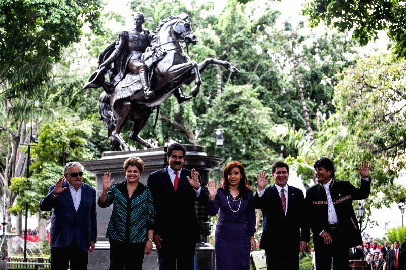 (From L to R) Uruguayan President Jose Mujica, Brazil's President Dilma Rousseff, Venezuelan President Nicolas Maduro, Argentina's President Cristina Fernandez, ...