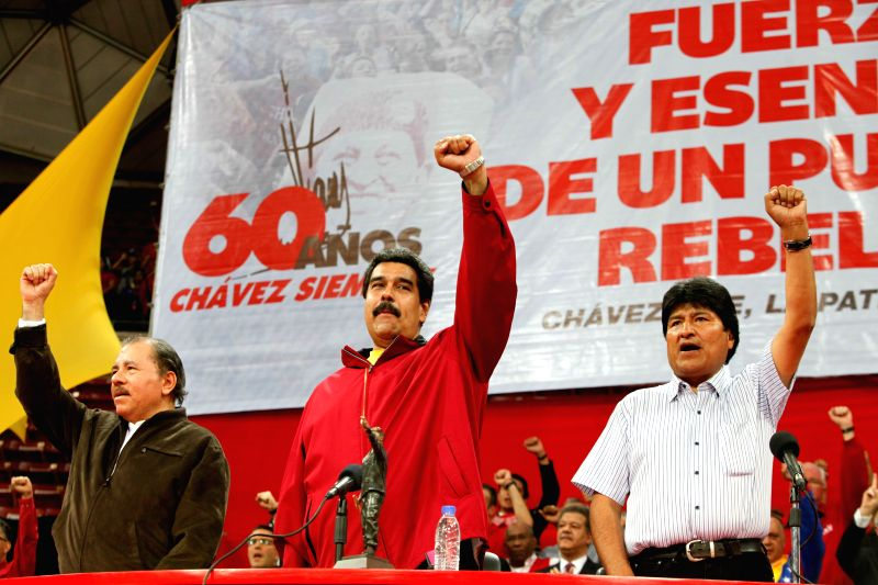 Venezuelan President Nicolas Maduro (C), Nicaraguan President Daniel Ortega (L) and Bolivian President Evo Morales (R)  participate in the solidarity act with the ..